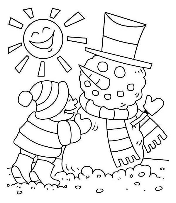 Young Little Kid Making Mr Snowman On Sunny Winter Season