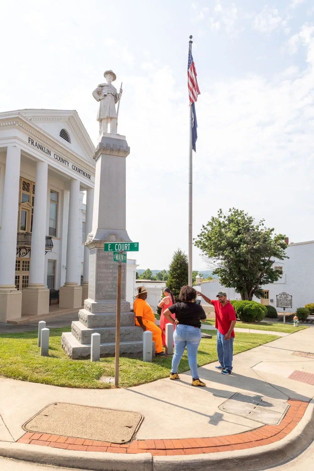 Man Henry Turnage Stands outside the Franklin County Courthouse demanding the removal of a Confederate Monument