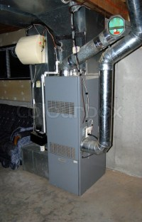 A residential oil furnace - forced hot air with central ...