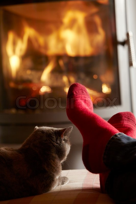 a sofa in the forties easy table diy close up of mans feet relaxing by cosy log fire with cat ...