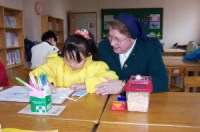 Sister Laurentia Harvey and little friend in Korea.