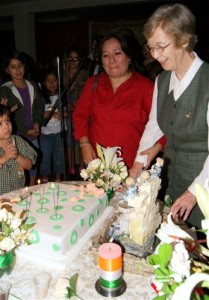 Sister Ana Maria preparing to cut and share the Golden Jubilee & Birthday Cake
