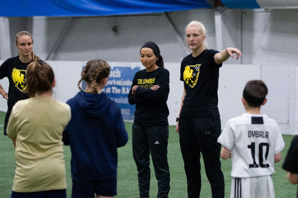 Monique Hanayik - Eagles defender and camps director - started the clinic off by addressing the campgoers at midfield | Ralph Schudel