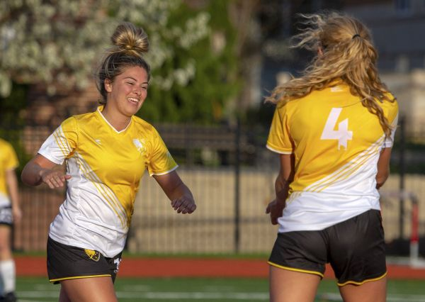 Brooklyn Pritt (left) celebrates her first goal against Otterbein University on April 14, 2019. The Eagles won 5-0. | Daniel Herlensky