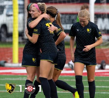 Madison Costner (center) celebrates her goal against Motor City FC on June 16, 2019. | Daniel Herlensky