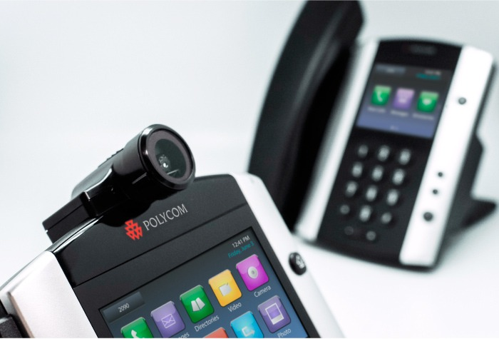 Image of Polycom VVX IP handsets. One IP handset in focus in foreground. One IP handset blurred in background.