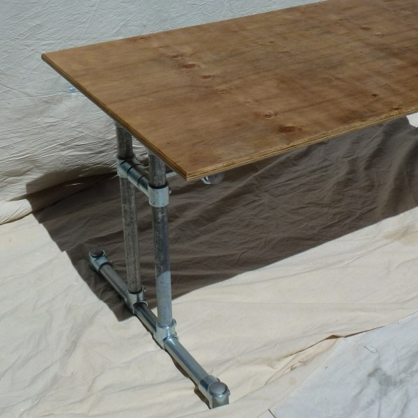Industrial Steel Dining Table with Reclaimed Plywood Top