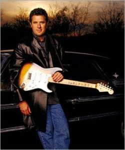 book or hire country musician Vince Gill