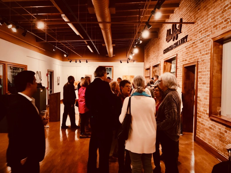 Gallery lovers mixing at Arts Clayton Gallery