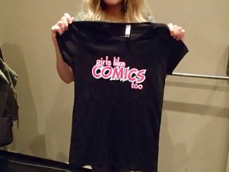 An artist from the Comic Book School classes shows off her Girls Like Comics Too shirt.