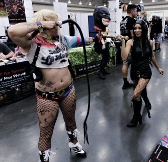 Chastity Wilson as Harley Quinn facing off against Cat Woman