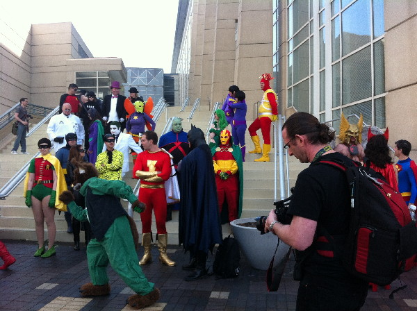 The traditional cosplay on the steps photo. So many primary colors.