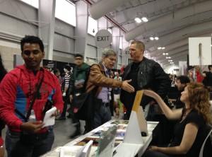 Paul Levitz stops to say hello to Bob Layton, Iron Man artist.
