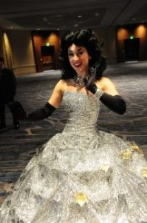 In Comic-Con fashion, this cosplayer features a dress that holds glasses of champagne for guests to take.
