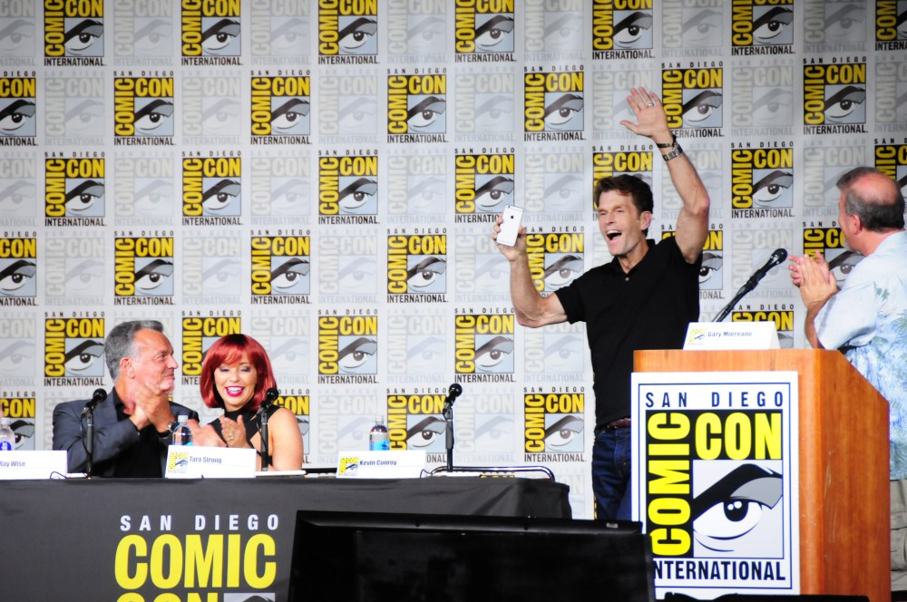 Kevin Conroy videos the crowd as he makes his entrance.