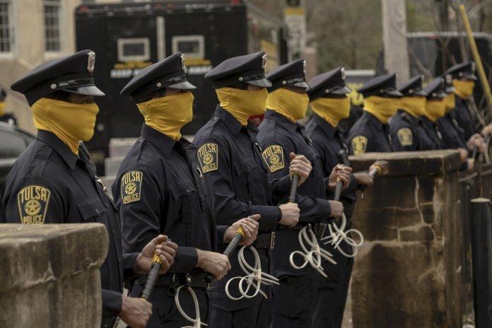 Cops line up at Nixonville in Watchmen