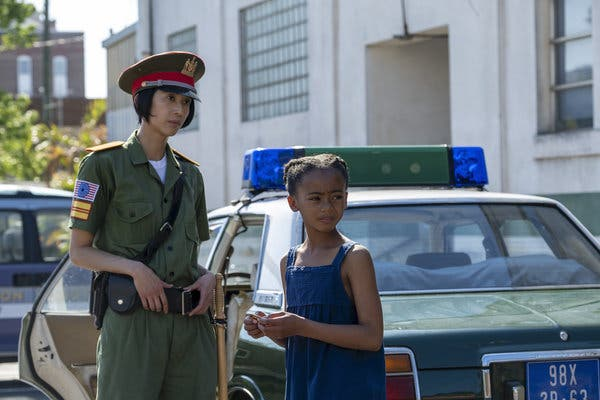 Angela receives a gift from a Saigon police officer on Watchmen
