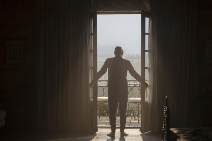 """Jean-Luc Picard opening the doors to his patio overlooking the vineyard Picard S1E1 - """"Remembrance"""""""