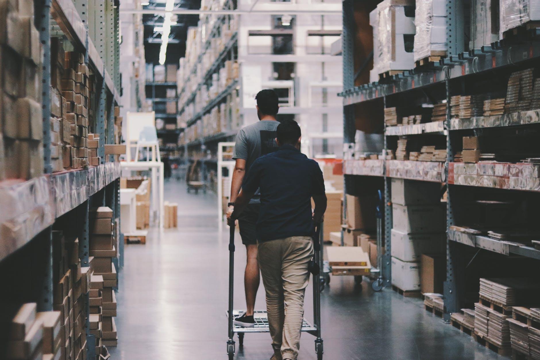 men going around a warehouse