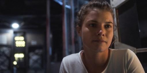 "Tracy Stevens (Sarah Jones) makes the ultimate sacrifice in ""The Grey"""