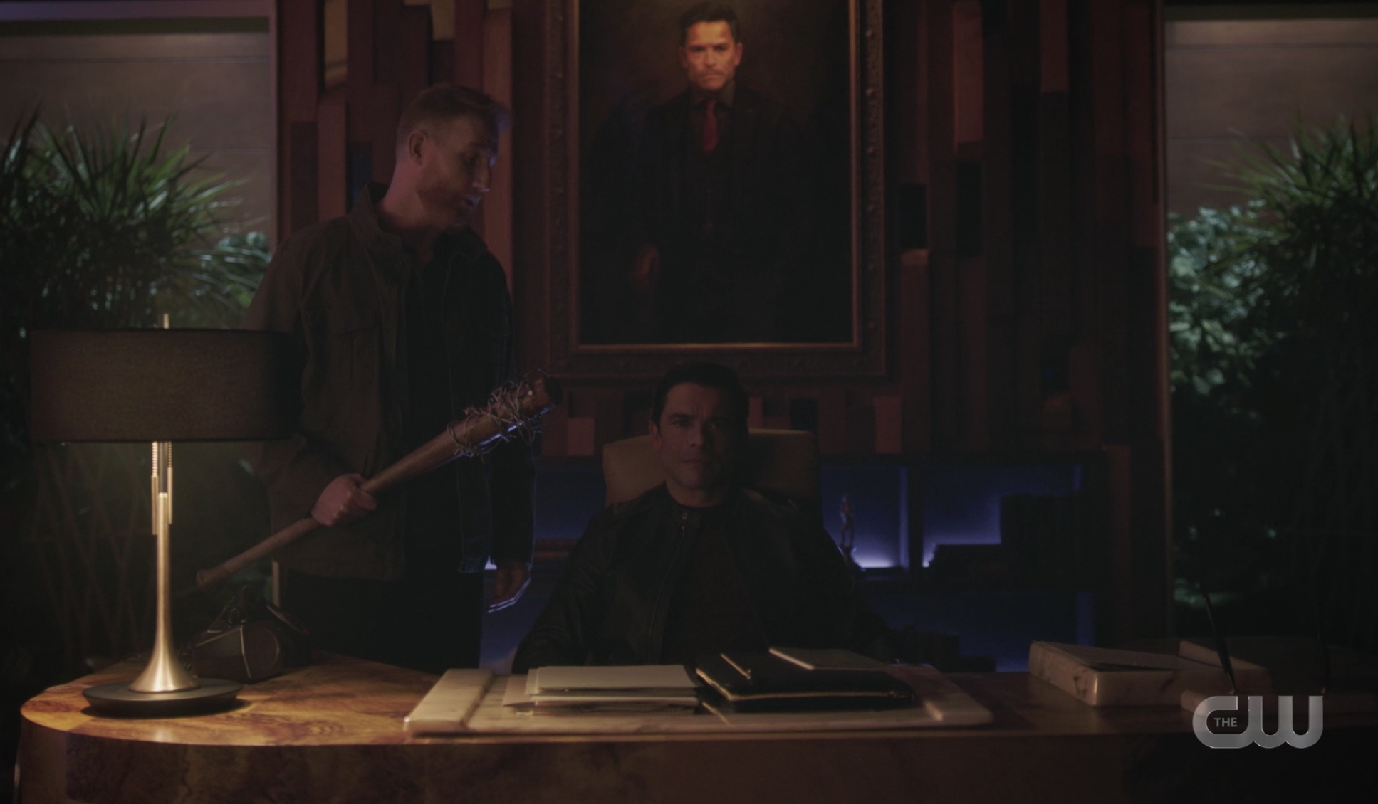 Hiram Lodge threatened by Ted and Lucille in his Riverdale office.