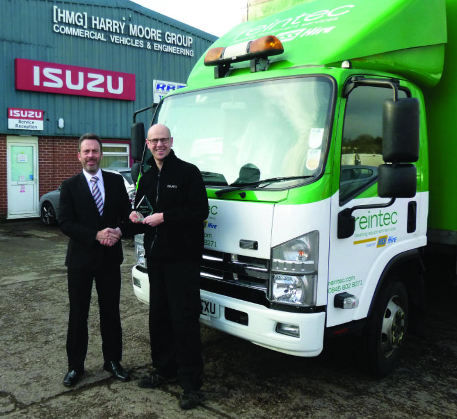 medium resolution of pride from left bob mcmullen regional network development manager isuzu truck uk with matt stubbs from harry moore commercials
