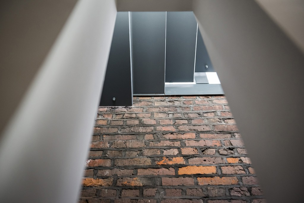 metal staircase and bare brick wall