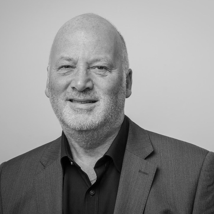 professional headshot of man in shirt and jacket in black and white