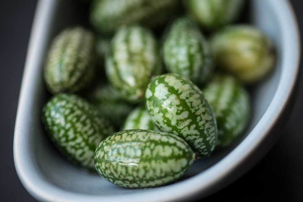 cucamelons in small pale earthenware dish