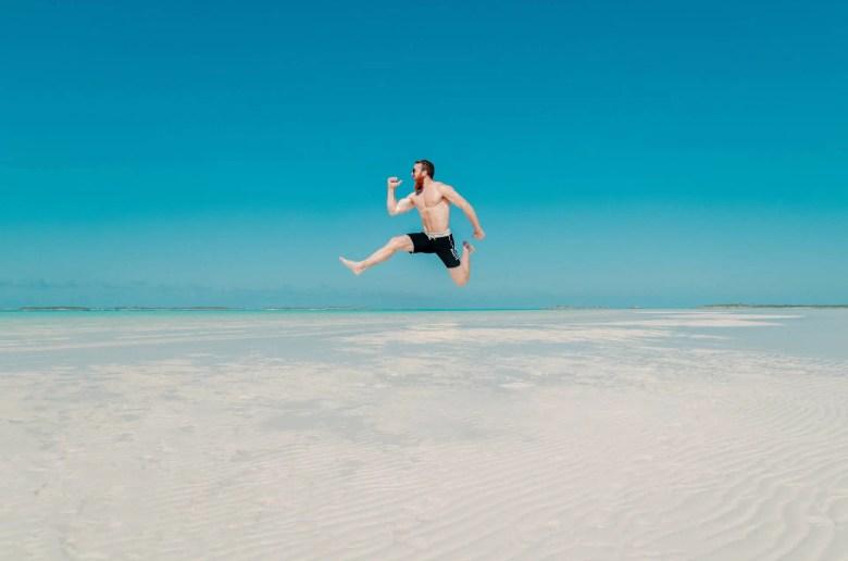 shirtless guy jumping