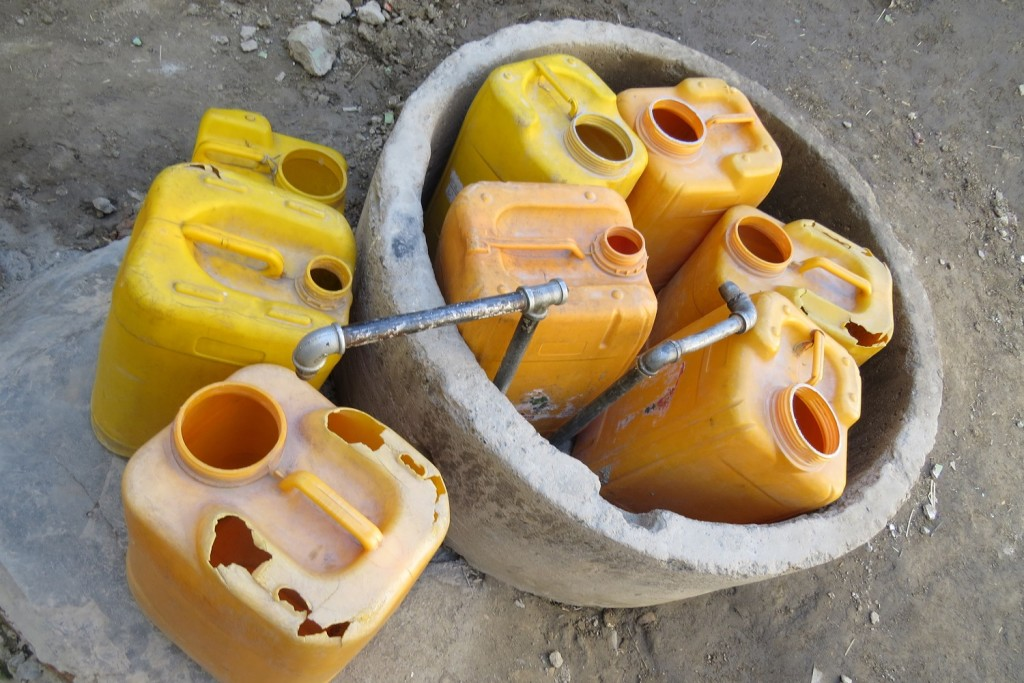 Containers at a well.
