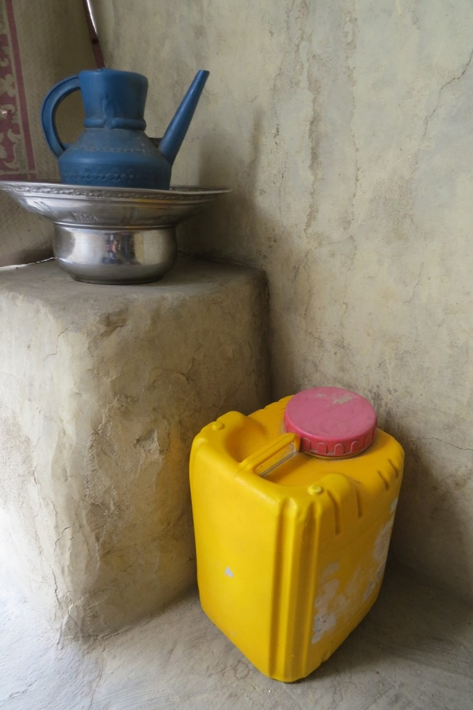 The pitcher and basin are ever-ready for the washing of hands before meals