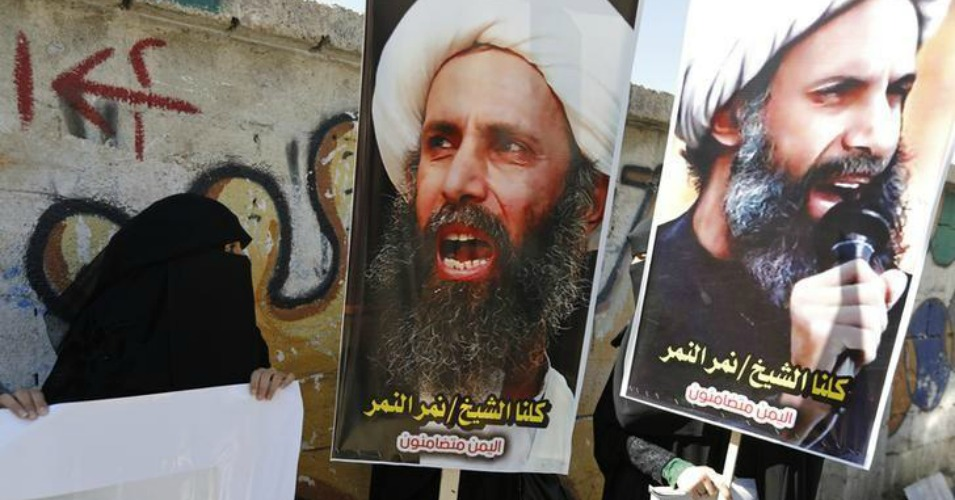 Shiite protesters carry posters of Sheikh Nimr al-Nimr during a demonstration outside the Saudi embassy in Sana'a on October 18, 2014. (Photo: Reuters)