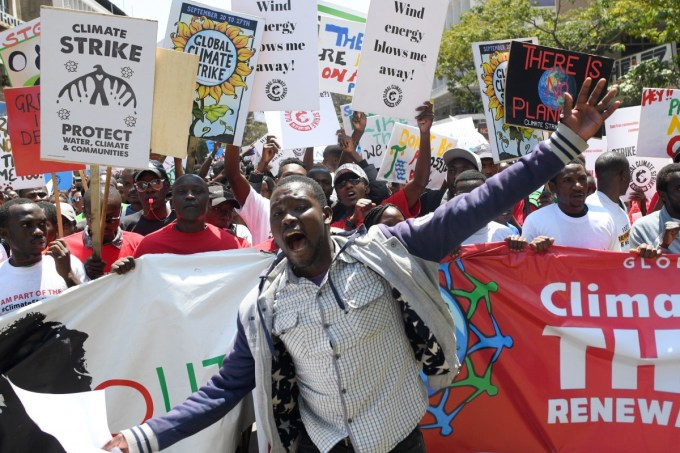 Environmental activists march carrying placards as they take part in a protest calling for action on climate change, in Nairobi on September 20, 2019. (Photo: Simon Maina/AFP/Getty Images)