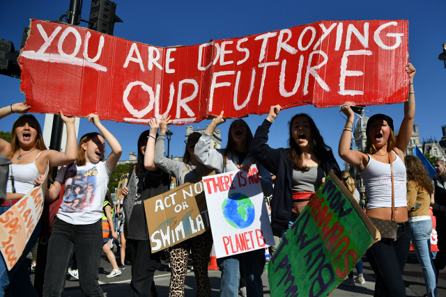 Environmental activists rally during the UK Student Climate Network's Global Climate Strike protest action in central London, on September 20, 2019. - Millions of people are taking to the streets across the world in what could be the largest climate protest in history. (Photo: Ben STANSALL/AFP/Getty Images)