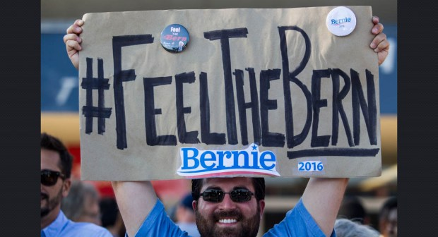 Feel The Bern - Frank Rothstein holds a sign before a rally for Democratic presidential candidate Sen. Bernie Sanders, I-Vt., Monday, Aug. 10, 2015, at the Los Angeles Memorial Sports Arena in Los Angeles. (AP Photo/Ringo H.W. Chiu)