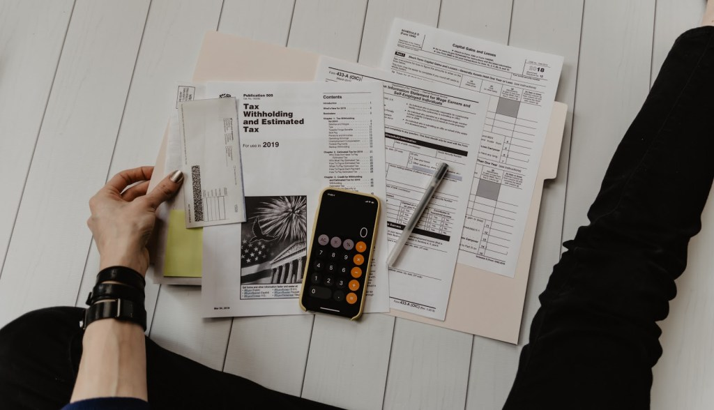 person rifling through tax papers