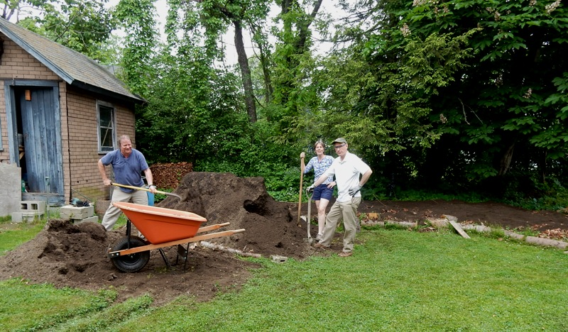 My daughter Betsy and her man Mike, throwing 8 yards of soil on the Hugel.
