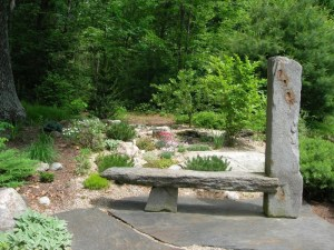 Stone bench and rockery garden