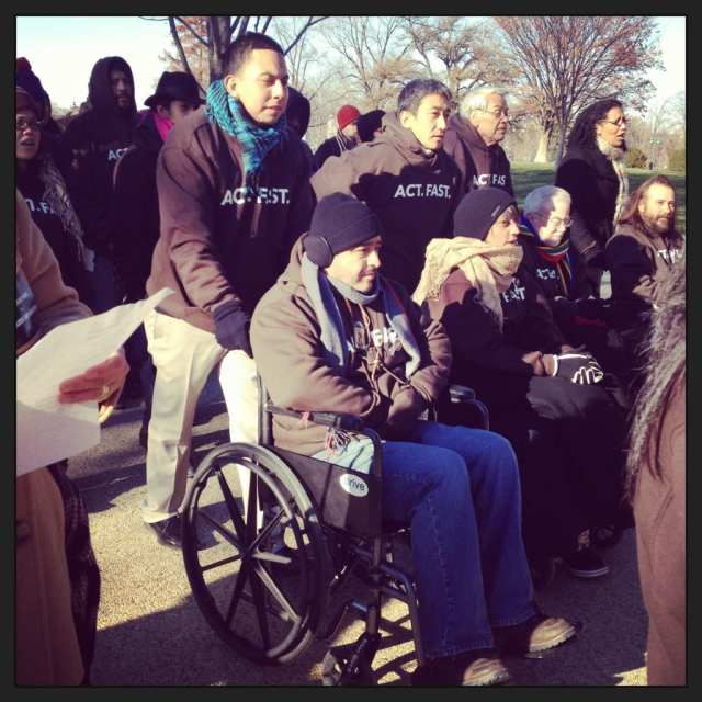 CCC employee Rudy Lopez leads the procession of supporters to the Fast for Families tent for the event. After fasting for 22 days, Rudy did not have the strength to walk and had to pushed in a wheelchair.