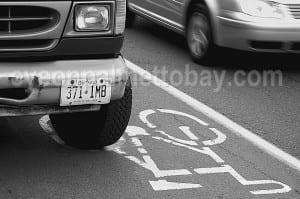 drivers in bike lanes
