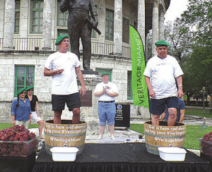 Coral Gables Farmer's Market on Saturday, Mar. 7, featured the Veritage Grape Stomping Competition. Pictured is the event champion, Chamber president Mark Trowbridge, in background, as he cheers on two competitors Jeffrey Welch, president and CEO of Coral Gables Hospital, and Coral Gables Mayor Jim Cason.