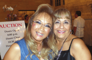 CGWC members Enid Miguez (left) and Ruth Martinez are pictured at Coral Gables Woman's Club Casino Night fundraiser.
