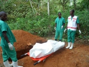Red cross workers prepare to bury a victim of Ebola. Photo credits: ©EC/ECHO/Jean-Louis Mosser