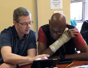 Volunteer working with Learner
