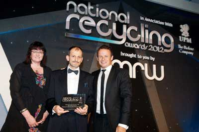 Richard Mehmed being presented with the Materials Recycler of the Year trophy