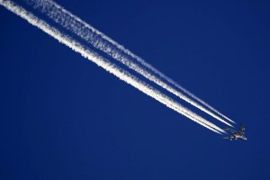 Emirates Plane Up High Over UK, Four Contrails