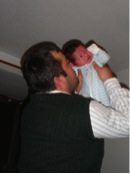 Iraqi man with his British born baby