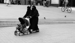 women in burquas with stroller