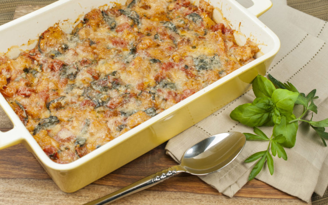 Rustic Tomato Spinach Bake is a homey casserole flavoured with garlic and fresh basil.